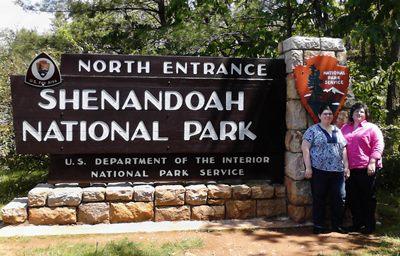 Women in front of Shenandoah National Park sign.
